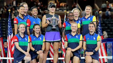 The spoils: Andreescu, of Canada, poses with the championship trophy.