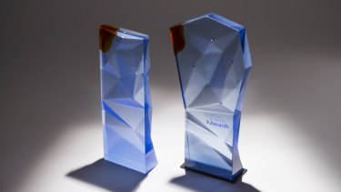 The Australian of the Year state (left) and national (right) trophies.