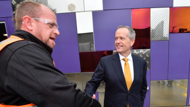 Jobs: Bill Shorten with a worker at Direct Edge Manufacturing in Burnie.