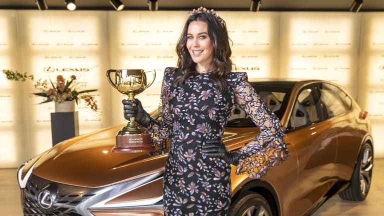 Megan Gale is seen holding the Lexus Melbourne Cup in Lexus ahead of the Melbourne Cup Carnival in Melbourne, Australia, Wednesday, October 31, 2018.