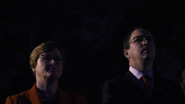 Senator Linda Reynolds and member for Perth Patrick Gorman stand in silence during the Last Post.