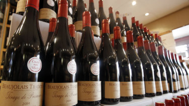 Bottles of Beaujolais Nouveau wine are displayed in a wine store at Issy Les Moulineaux, outskirts of Paris.