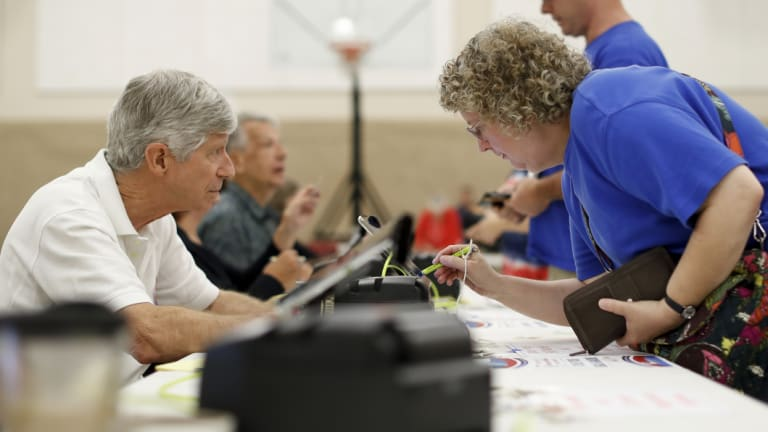 Voters sign in to cast their ballots in a polling station in Westerville, Ohio.