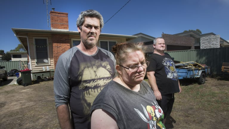 Ronald Lyons, Christine Lyons and Peter Arthur outside their home in Kangaroo Flat.