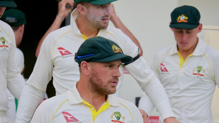 Capped: Aaron Finch sports his new baggy green for Australia on the first day of t   he first Test against Pakistan in Dubai.