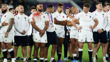 Crestfallen: England watch on during the presentation ceremony.