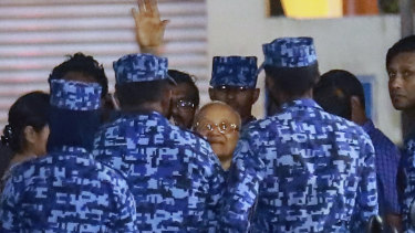 Policemen arrest former Maldives president and opposition leader Maumoon Abdul Gayoom early on Tuesday.