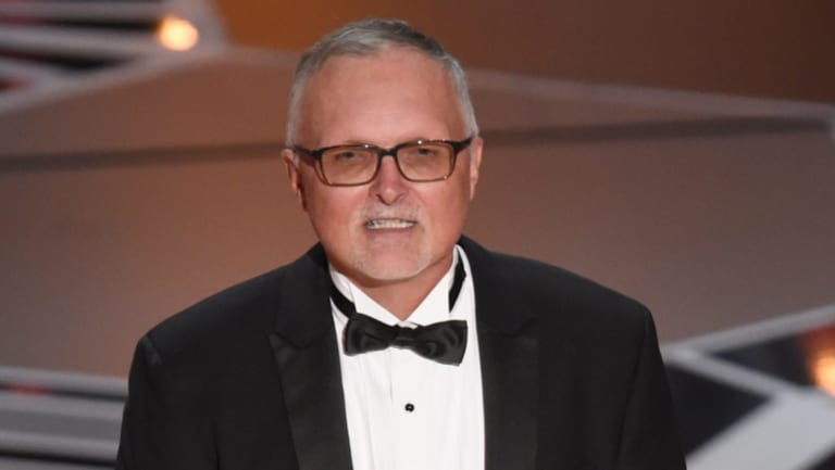 Lee Smith accepts the Oscar for best film editing for <i>Dunkirk</i>.