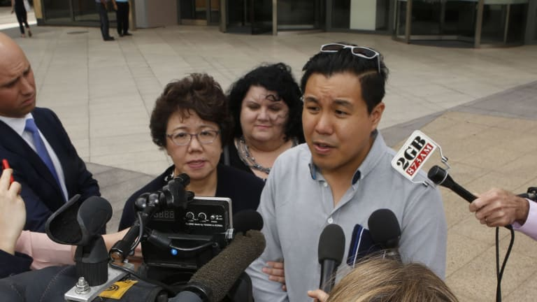 Curtis Cheng's son Alpha Cheng and widow Selina Cheng speak outside the court