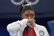 Simone Biles watches after exiting the team final.