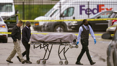 A body is taken from the shooting scene at the FedEx facility in Indianapolis.