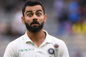 Eye opener: Kohli leaves the field at stumps after batting India back into contention.