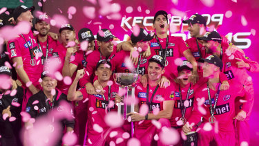 The Sydney Sixers celebrate winning last summer's BBL.