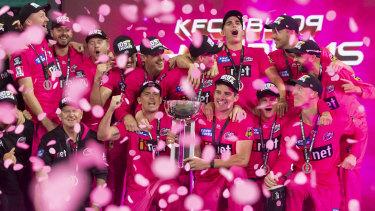 The Sydney Sixers celebrate winning last summer's BBL.