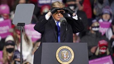 US President Donald Trump surveys the crowd in Nebraska.