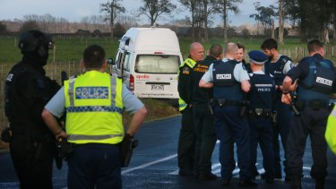 Police near the campervan where Sean McKinnon's body was found.