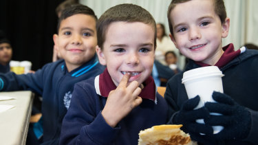 Connor Rusteau-Hagarty with brothers, Jaykob and Blair Cash at the free breakfast club at their school.