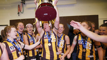 Hawthorn players celebrate after winning the VFLW grand final in 2018.