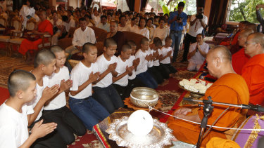 Members of the Wild Boars soccer team serving as novice Buddhist monks.