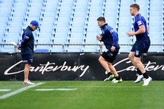 Kieran Foran is put through his paces as Dogs medico Tony Ayoub (left) looks on.