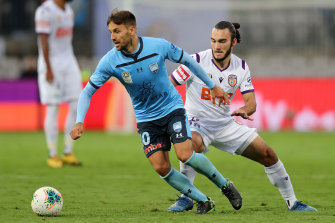 Milos Ninkovic skips away from Nick D'Agostino in Sydney's 0-0 draw with Perth Glory on Saturday - one of the last A-League games that will be open to the public this season.
