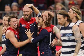 Max Gawn celebrates with teammates.