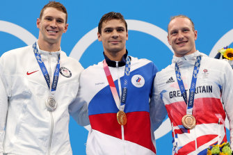 The podium for the men's 200m backstroke (from left): the USA's Ryan Murphy, ROC's Evgeny Rylov, and Britain's Luke Greenbank.