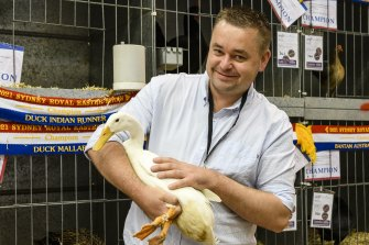 Danny Benn with Ferdinand, the Indian Runner Duck, that won bird of the year at the Sydney Royal Easter Show. It is the first time in 199 years that a duck has won the high honour.