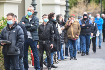 People were turned away from the Exhibition Building after queuing for hours for a Pfizer vaccine.