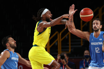 Australia's star player Patty Mills passes the ball.