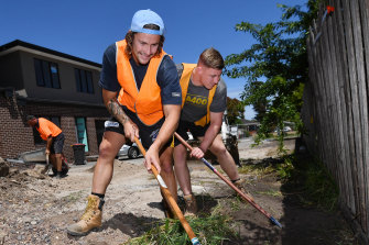 Melbourne Storm's Nicho Hynes and Max King doing labouring in Clayton South.