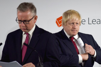 Cabinet minister Michael Gove, left, was forced to defend British Prime Minister Boris Johnson, right, following a report critical of the government's preparation for the coronavirus.