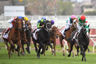 Jockey Damian Lane steers Mer De Glace to victory at the 2019 Caulfield Cup.
