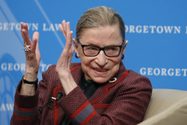 Supreme Court Justice Ruth Bader Ginsburg applauds after a performance in her honour in 2018.