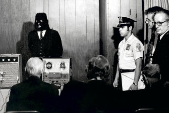 Alan Abel wears a mask posing as a White House official claiming to have the missing 181/2 minutes from the Watergate tapes. When the tape was played at a news conference, the reporters were greeted with silence.