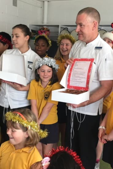Calli from Weetangera School only had eyes for the brownies when Executive Chef from Parliament House David Learmonth visited the school