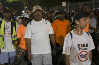 Port Moresby Governor Powes Parkop (centre) on his predawn walk with citizens.