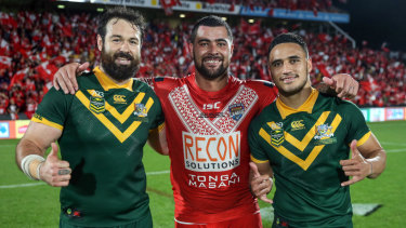 Mate against mate: Fifita poses with Aaron Woods and Valentine Holmes after the Tonga v Australia Test last year.
