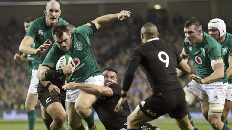 Breakthrough: Ireland's Cian Healy runs with the ball during his side's stunning victory over New Zealand.