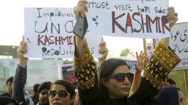 Pakistani civil society activists rally to express solidarity with Indian Kashmiris in Lahore, Pakistan.