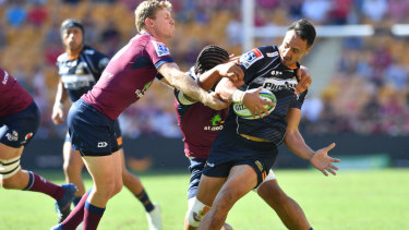 Brumbies winger Lausii Taliauli in action against the Queensland Reds.