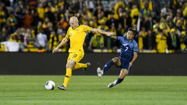 Australia's Aaron Mooy in action against Abishek Rijal.