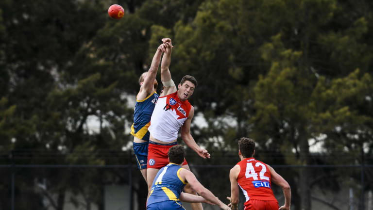 Canberra's Cameron Milne and Sydney's Darcy Cameron contest the ball.