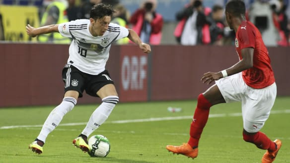 German soccer boss admits mistakes in Ozil furore