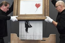 Banksy's shredded version of Girl with Balloon has been retitled Love is in the Bin.