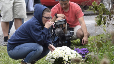 Flowers are placed at the scene where 20 people died in the crash.