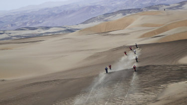 Competitors ride during stage nine of the Dakar Rally in Peru.