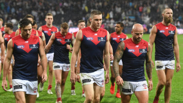 The Dees leave the field after their loss to Geelong.