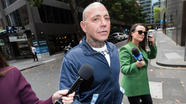 Mongols bikie boss Toby Mitchell leaves his lawyer's office after Monday's court case.