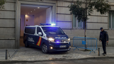 A Spanish National Police van, believed to be carrying Catalonian politicians and activists, arrives at the Spanish Supreme Court in Madrid on Wednesday.